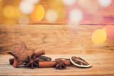 Christmas wooden background with spices, orange, cinnamon, stars - 178784908