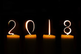 2018 written with candle flames on black background - 178785520