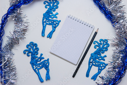 Christmas shopping list on white wooden background. holiday deco Poster