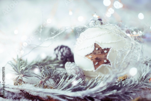 Christmas Still Life  -  Natural decoration with white christmas bauble and fir branch on snow background  -  Greeting card - 178809735