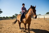 Girl riding a horse in the ranch