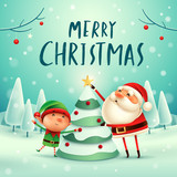 Merry Christmas! Santa Claus and Elf decorate the Christmas tree in Christmas snow scene. Winter landscape. - 178825186
