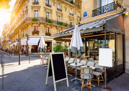 Typical view of the Parisian street with tables of brasserie (cafe) in Paris, France - 178828138