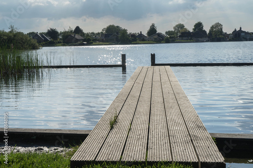 Fotobehang Pier Pontoon and lake in Zwartsluis, in the Weerribben-Wieden National Park, near Giethoorn, Netherlands
