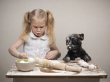 Funny dog and child - cooks. All covered with flour. Fun and interesting - 178850586