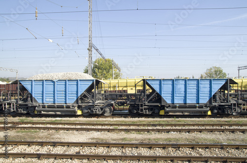 Two freight wagons with gravel on the siding Poster