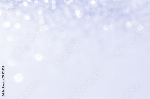 Soft violet or blue bokeh light is the soft blurred circles of light white and light purple