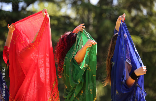 Plakat Three women during a dance with long colorful clothes
