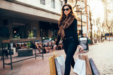 Young woman with shopping bags - 178883393