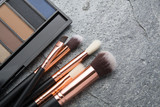brush makeup products on dark background - 178890573