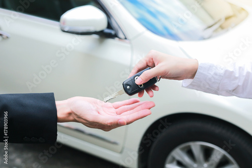 Closeup Of A Female Car Owner Giving Car Keys From The Car Dealer