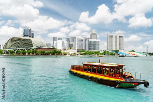 Traditional tourist boat sailing along Marina Bay, Singapore
