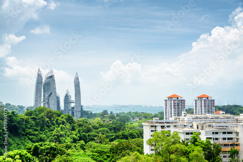 Summer cityscape in Singapore. Skyscrapers among green trees
