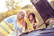 Two beutiful women having trouble with car.
