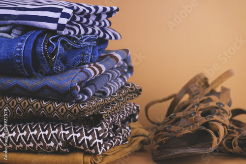 Women's shoes, clothing and accessories on a colored background плакат