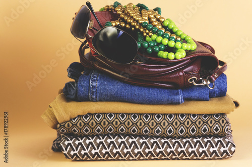 Poster Women's shoes, clothing and accessories on a colored background