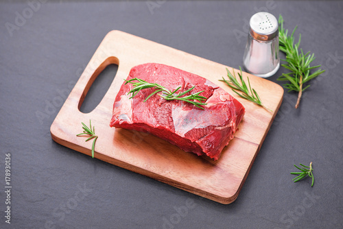 Fotobehang Steakhouse Raw beef cooking with ingredients. Top view with copy space