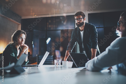 Business people meeting concept.New project team manager making conversation at meeting room with partners at office.Horizontal.Blurred background.Flares.