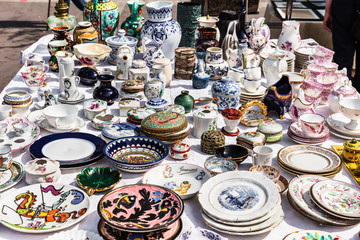 Old vintage objects and furniture at a garage sale at the flea market in Paris. France