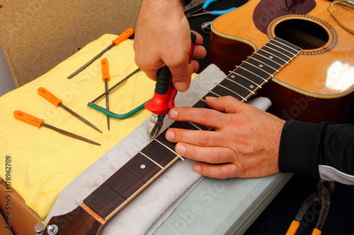Acoustic Guitar on the Luthier Table Poster