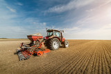 Tractor plowing fields -preparing land for sowing in autumn - 178975511
