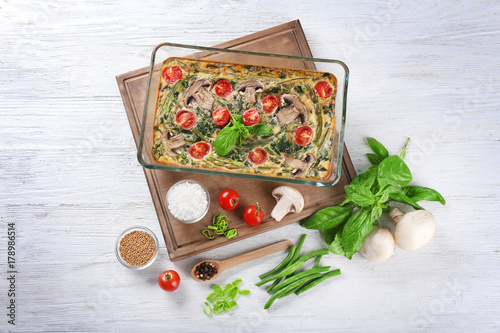 Fotobehang Kruiden 2 Composition with spinach frittata in baking dish and vegetables on table