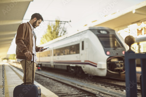 Young man in train station waiting for travel