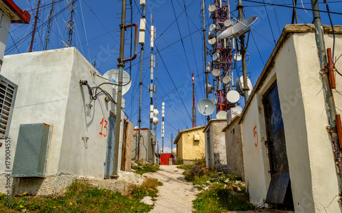 Poster Smal steegje Antennas station on top of a mountain at Corfu Greece.