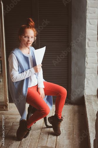 young hipster student woman or creative freelance designer working on project Poster