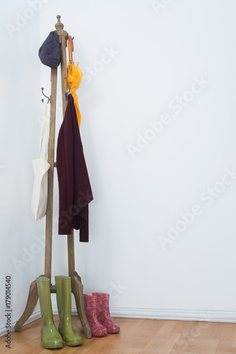 Hat, umbrella, jumper, grocery bags and wellington boots on Poster
