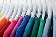 Colorful t-shirts arranged in a row