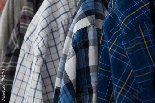 Close-up of colorful shirts плакат