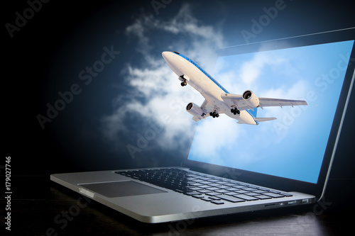 Airliner coming from laptop. Mixed media