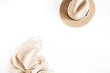 Fashion look with pale pastel beige hat and scarf on white background. Flat lay, top view. - 179035194