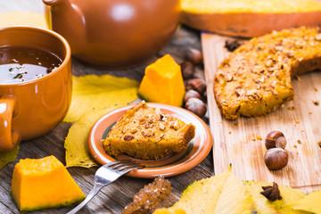 Autumn Composition with Pumpkin Pie and Tea