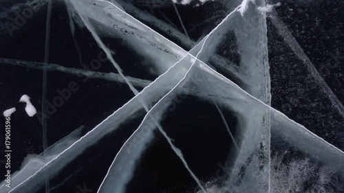 Poster Water planten Triangle cracks beautiful unique largest freshwater lake Baikal, Russia. Cold winter day. Transparent clean ice. Close-up from above gimbal drone Steadicam 4k cinematic