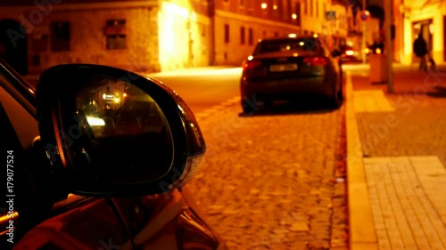 Foto op Plexiglas New York TAXI Rear-view Mirror of Car in the Night Town. Time Lapse.
