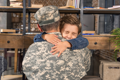 military father and son embracing