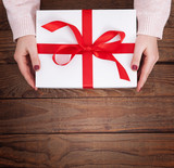 Present. Gift box. Woman holding small gift box with ribbon. - 179114989