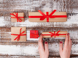 Present. Gift box. Woman holding small gift box with ribbon. - 179115101