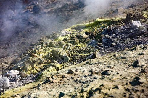 Fotobehang Aubergine Sulfur haze and crystals on the rocks. Volcano or Vulcano Island in the archipelago of Aeolian Islands close to Sicily - Italy.