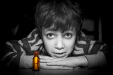 Boy trustful look and his message in a bottle, portrait.
