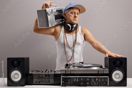 Old DJ with a boombox and musical equipment Poster