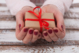 Present. Gift box. Woman holding small gift box with ribbon. - 179118918