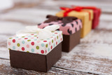 Present. Gift boxes on wooden desk. - 179118972