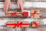 Present. Gift box. Woman holding small gift box with ribbon. - 179118995