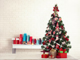 Christmas tree with present boxes over white brick wall - 179125539