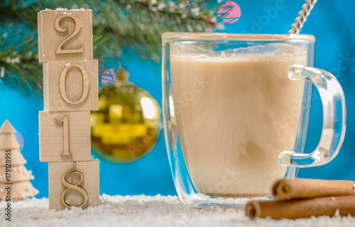 Foto op Aluminium Milkshake 2017 cubes. Christmas card. Christmas tree and balls blurred background. Traditional drink of eggnog with cinnamon.