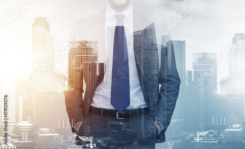close up of businessman over city buildings