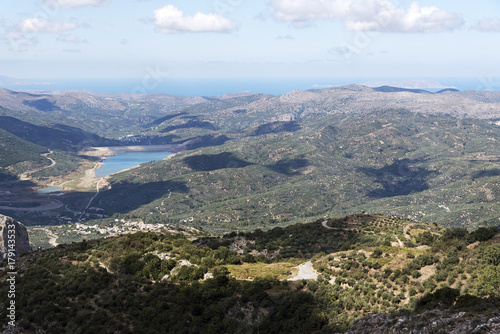 Aluminium Blauwe hemel View across mountains of a water reservoir from the mountain road at Ano Kera, Lasithi, Crete, Greece. October 2017